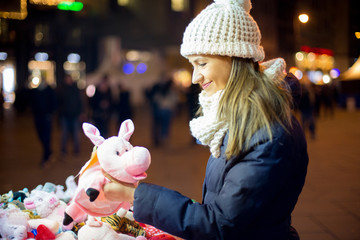 Young woman looking toys at street