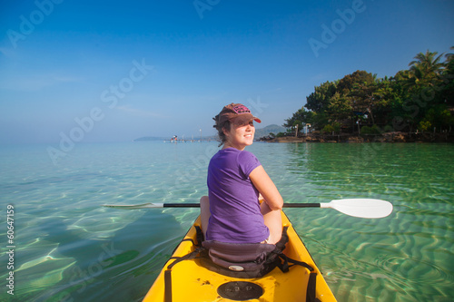 Beautiful girl on a kayak