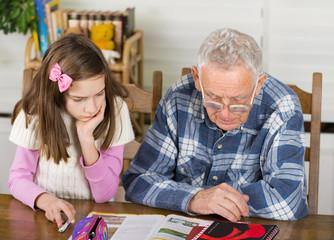 Grandpa and girl study