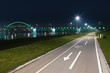 Bicycle lane and bridge at night