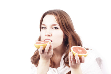 young girl with grapefruit on white