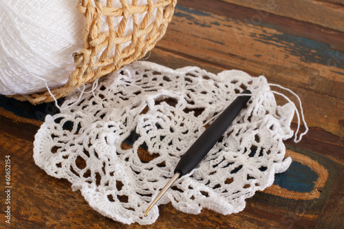 Crochet doily on wooden table