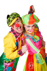 Two clown smiling isolated over a white background