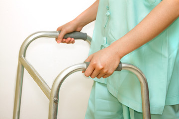 patient woman using a walker,walking aid for training