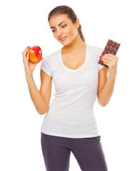 Young girl with apple and chocolate