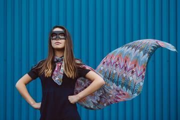 Girl in black superhero mask