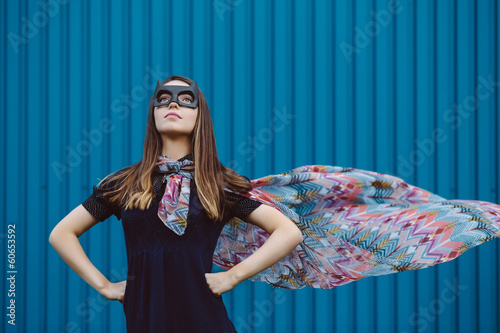 Girl in black superhero mask