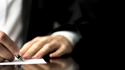 Businessman writing correspondence