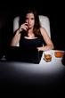 Young woman using laptop drinking wiskey and smoking