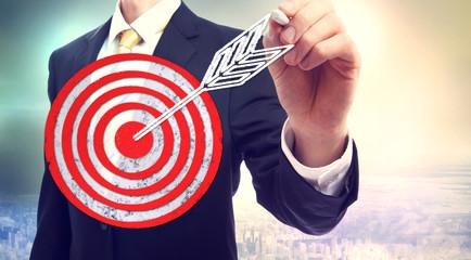 Business man drawing target