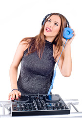 Beautiful Sexy Young Woman as DJ playing music on (pickup) mixer