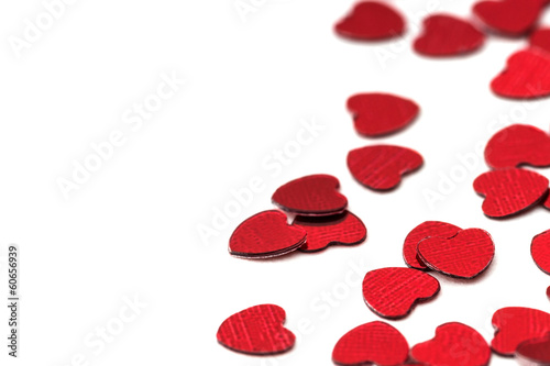 Valentines decoration of red confetti hearts against