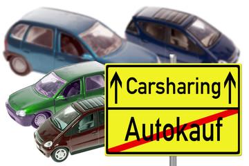 Modellautos mit Schild Carsharing / Autokauf