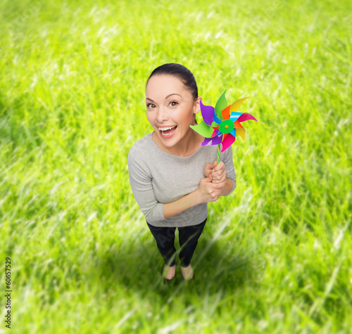 smiling asian woman with windmill