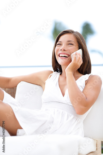 Phone woman talking on smartphone - on sofa