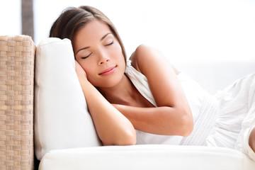 Sleeping beauty woman on sofa - sleep in dress