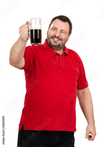 Bearded man stares at a dark beer mug