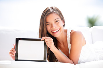 Tablet computer. Woman showing blank screen happy