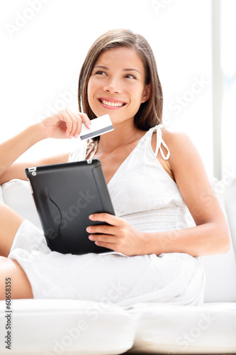 Woman shopping on tablet computer with credit card