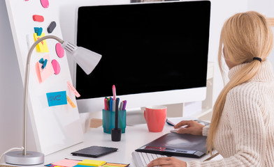 Woman creative professional using pen tablet and computer