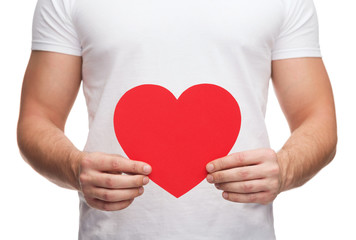 closeup of man hands with heart