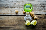 Glass of absinthe with lime and sugar cubes poster