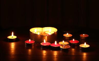 Burning candle heart shape