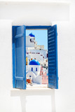 Open traditional Greek blue window on Santorini island, Greece