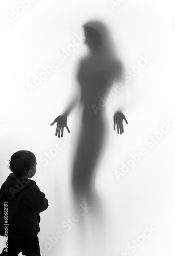Beautiful woman silhouette vision and a young boy