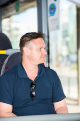 man traveling by bus