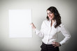 beautiful young businesswoman holding white board