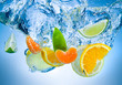 Tropical fruits fall deeply under water with a big splash - 60664168