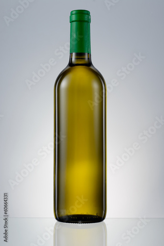 Dark green glass bottle with white wine isolated