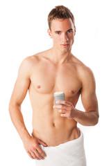 Young man using antiperspirant