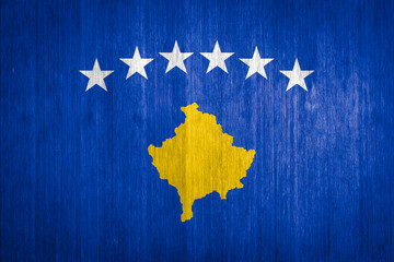Kosovo Flag on wood background