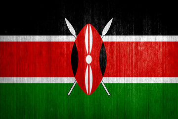 Kenya Flag on wood background
