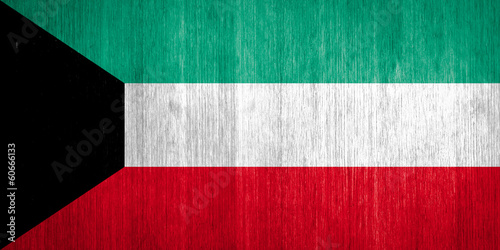 Kuwait Flag on wood background