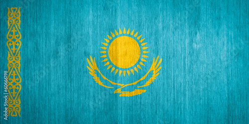 Kazakhstan Flag on wood background
