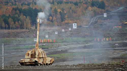 A self-propelled armoured howitzer fires at the landfill