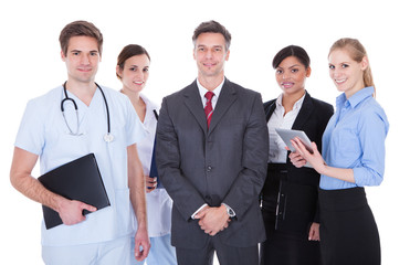 Group Of Businesspeople And Doctors