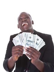 Businessman Holding American Dollars