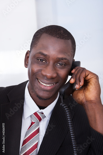 African Businessman Working At Office
