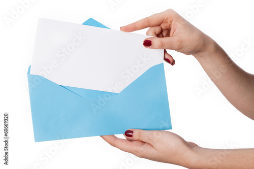 Women's hand with envelope and card for your own text