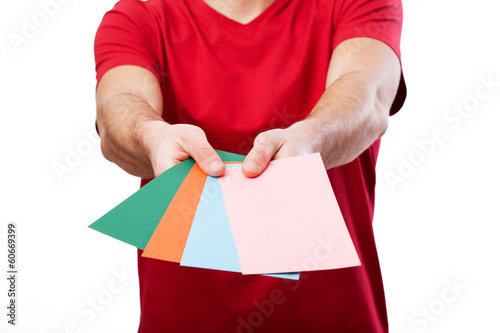 Man holding colorful cards for your own text