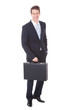 Portrait Of Young Businessman Holding Briefcase
