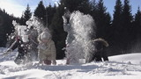 Playing in the Snow. Slow Motion at a rate of 240 fps