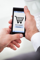 Mobile With Online Shopping Application On A Screen