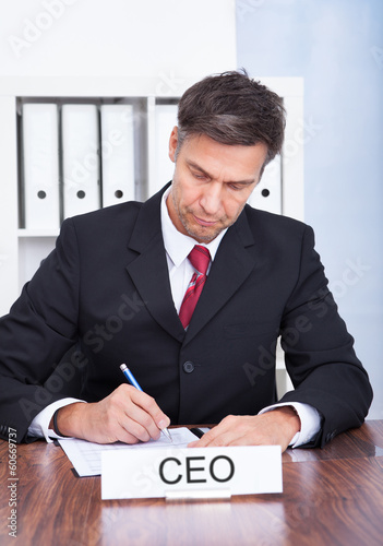 Male Ceo Working At Office