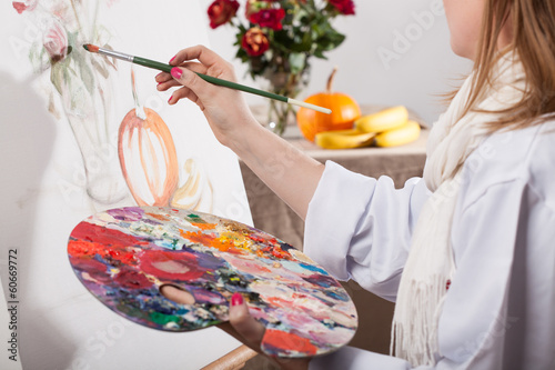Young talented woman painting