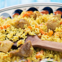 Close-up of uzbek national dish pilaf or plov